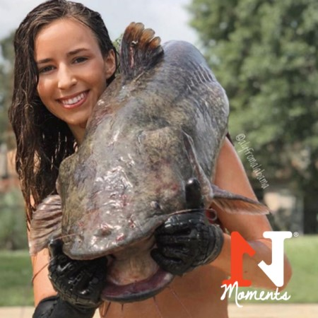 noodling aly from alabama catfish over shoulder