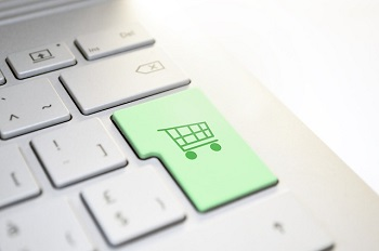 computer keyboard with shopping cart button in green